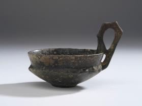 Small cup with crested handle