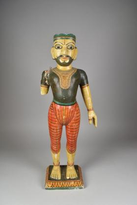 Standing male wooden figure