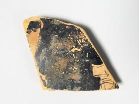 Red-figure vessel fragment with the forehead of a figure