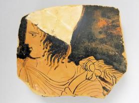 Red-figure vessel fragment with a man wearing a pileus