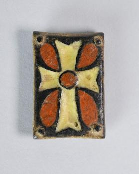 Belt plaque with cross