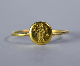 Ring with figure of a standing man