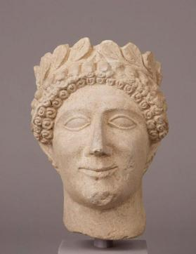 Head of a beardless wreathed youth