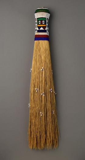Broom with beaded handle