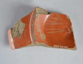 Samian ware dish base fragment with grafitto