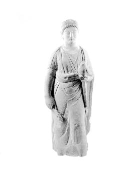 Figure of a male votary holding a branch and a dove