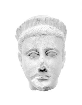Wreathed head of fragmentary male votive figure