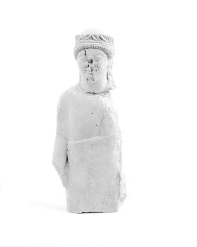Fragmentary figure of a wreathed male votary