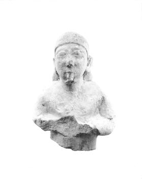 Fragmentary figure of a musician playing a double flute