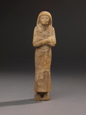 Uninscribed shabti wearing dress of daily life
