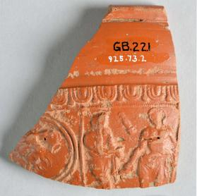 Samian ware bowl fragment with double-bordered ovolo band, lion, and two figures