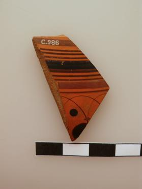 Fragment from the body of an Attic cup (possibly a Droop cup) with black figure technique decoration with a lotus bud pattern.
