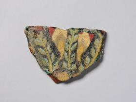 Fragment of an inlay plaque with floral motifs