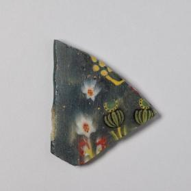 Fragment of an inlay plaque with floral motif