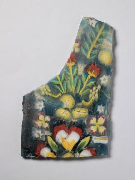 Fragmentary inlay plaque with floral motif