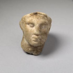 Head from a fragmentary miniature figure