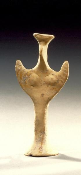 Psi type female figure with arms raised