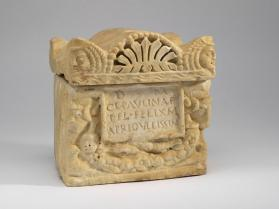 Cinerarium (lid) carved to imitate a constructed tomb in miniature