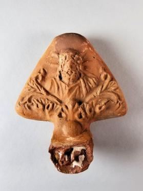 Handle guard from an oil lamp with bust of Zeus-Serapis