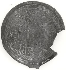 Fragmentary mirror with two youth wearing Phrygian hats