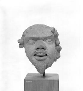 Figural head of  a Demon