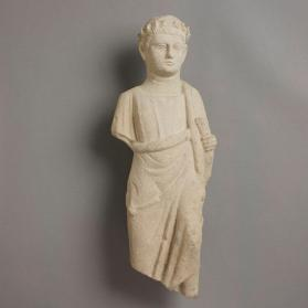 Figure of a male votary holding a scroll