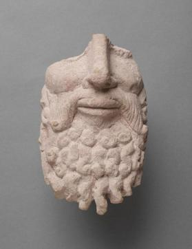 Fragment from the face of a large bearded figure