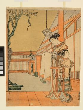 A courtesan reading a letter, attended by a kamuro holding a tray