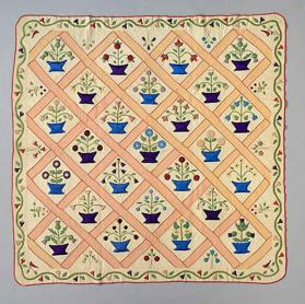 Appliqué quilt with flower pot design