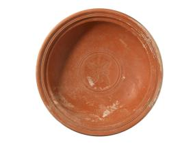Shallow bowl stamped with four palm leaves and rosettes