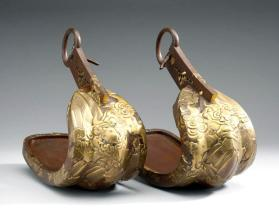 Pair of stirrups with shishi (Buddhist lion-dogs)