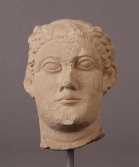 Head of a wreathed male votary figure