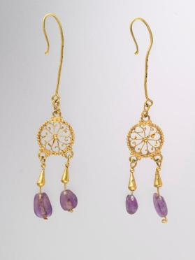 One of pair of pendant earrings