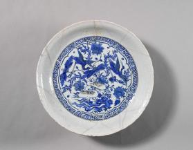 Dish with Chinese waterfowl scene and faintly carved walls