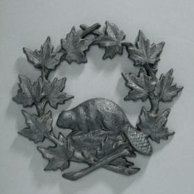 Ornament, wreath of maple leaves and beaver
