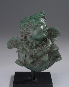Furniture applique of cupid facing left