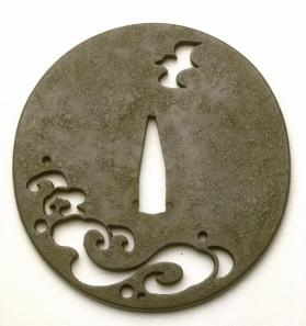 Tsuba (sword guard);  pierced design of sea bird and waves