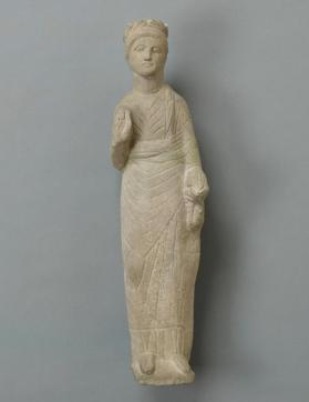 Figure of a male votary holding a dove