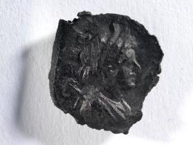 Seal impression of female bust crowned with corn