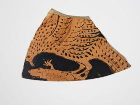 Red-figure vessel fragment with an eagle holding a lizard in its talons