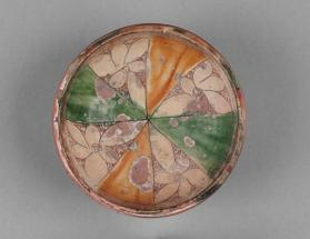Bowl decorated with six-petalled rosettes