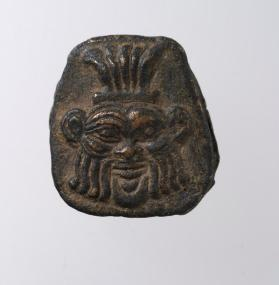 Punch with head of the Egyptian deity Bes