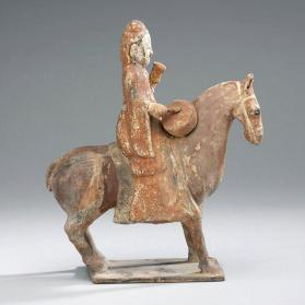 Burial figure of a mounted male musician with a drum