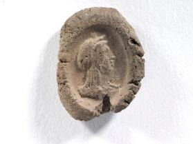 Seal impression of Isis, draped, with crown, hair in three plaits
