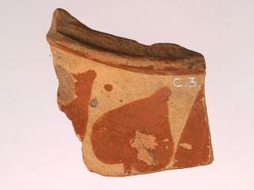 Shoulder fragment from an East Greek Fikellura amphora or oinochoe, decorated with an ivy-like leaf motif.
