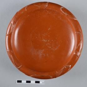Samian ware dish with barbotine leaf motif