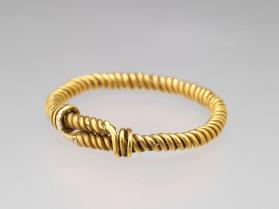 Bracelet of twisted wire with coiled clasps