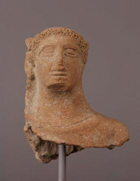 Head and partial torso of a female votary figure