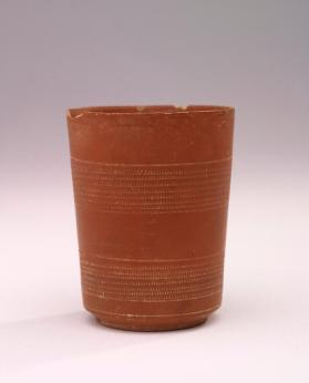 Arretine ware cylindrical beaker with two zones of rouletting