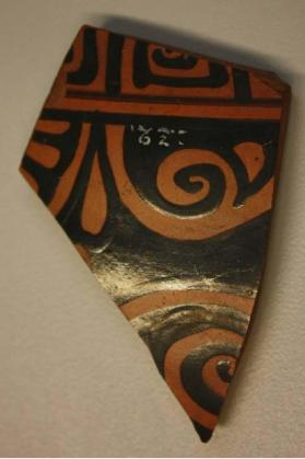 Fragment of an Attic krater, decorated in red figure technique with a palmette and meander pattern.